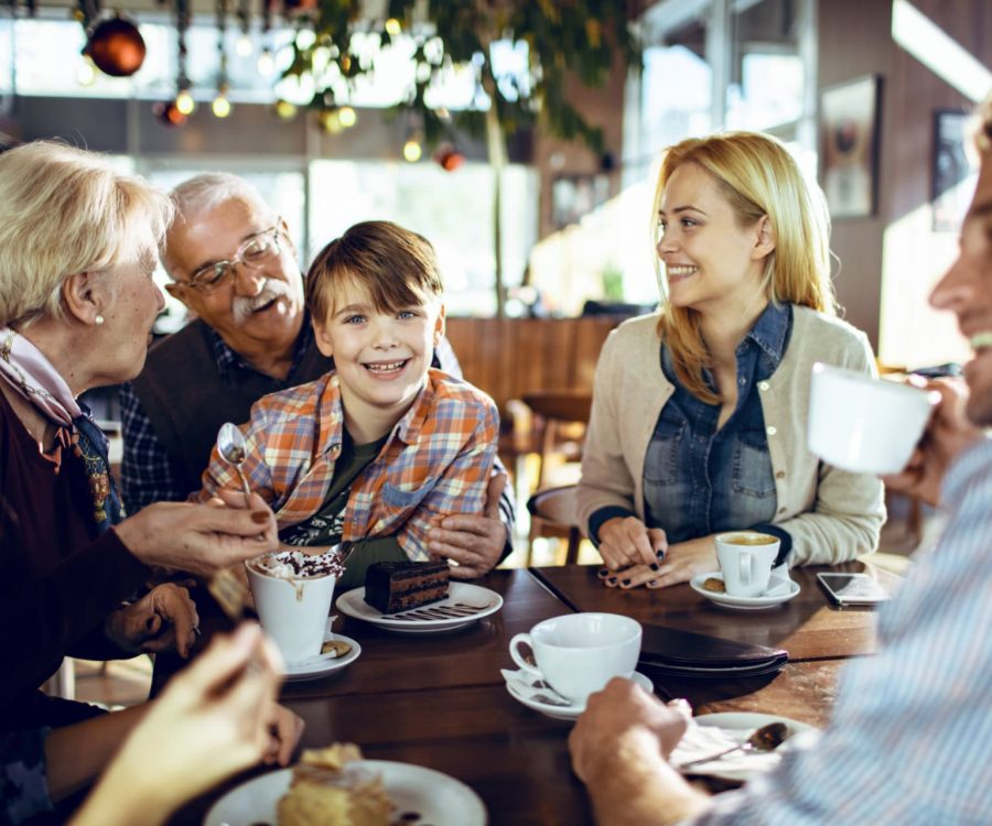Close up of a multi generational family spending time during the holidays together in a cafe